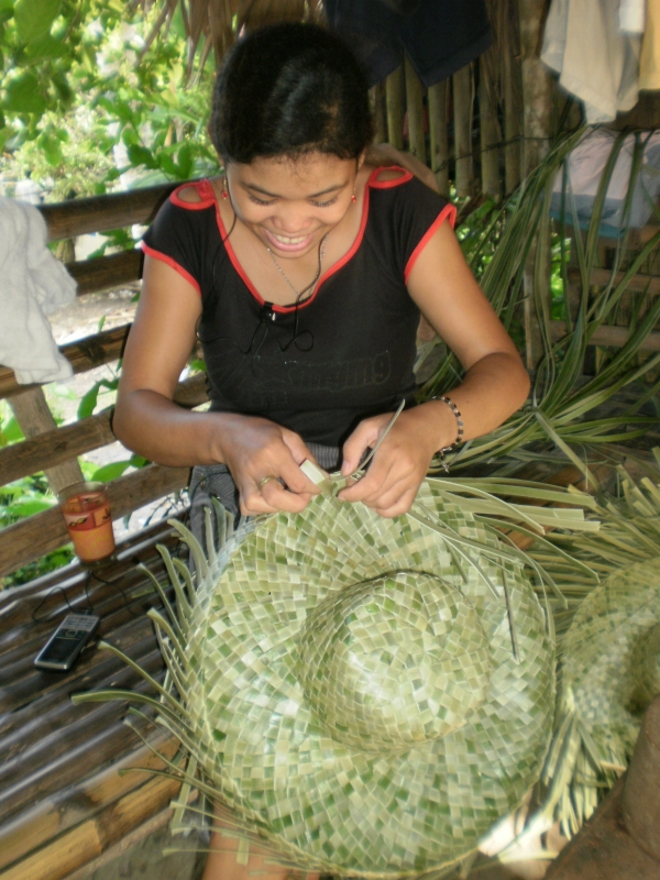 Cell phone is indispensable in today's world even for this teen hat weaver in Bulusan.