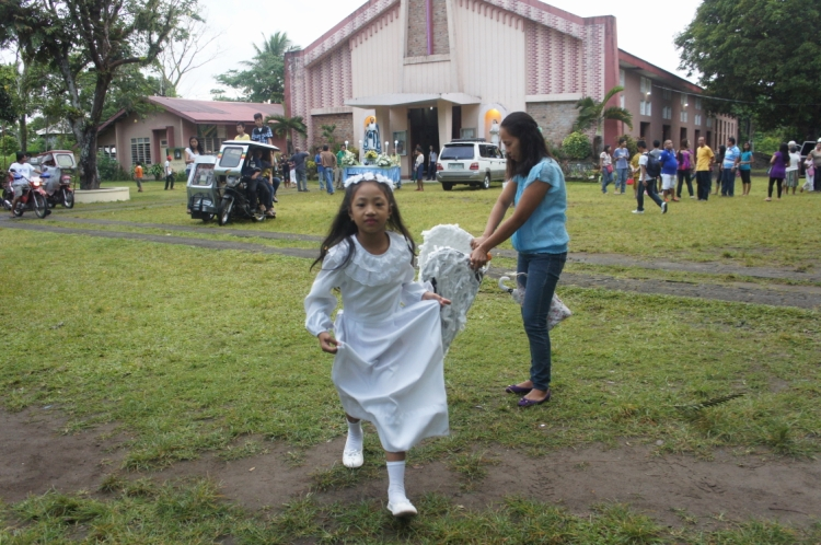 An angel shed her wings after the Easter Sunday choir chores