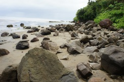 Boulders strewn along the beach that look like remnants of past volcanic eruption form an impressive Rock Beach landscape adding a sense of excitement and energy to the mysterious Mapaso spring.