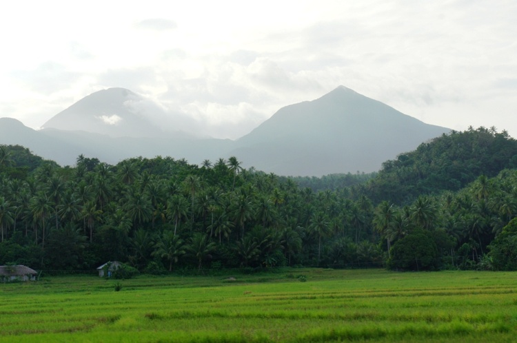 Mirage-like image of Mt. Bulusan provides a backdrop for the lush green of the rice fields that constantly depend on its mountain waters for irrigation.