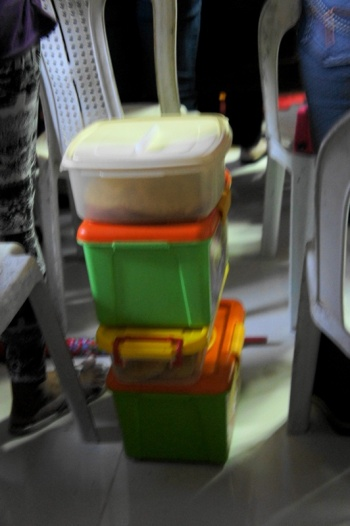 Utility recycled plastic biscuit boxes are the most common mamon/bread containers for this event.