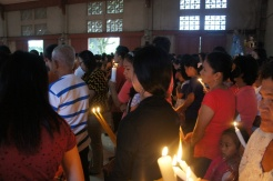 Candles for blessing come in all sizes but usually colored with the traditional white and yellow.