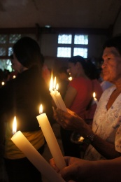 Some parishioners brought not just one but two or more candles each.
