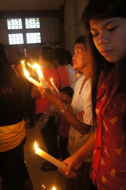 Jomabel with a local parishioner from the Poblacion.