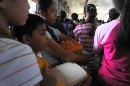 Contented faces and container sealed after the final blessing rites of the mamon and candles are completed.