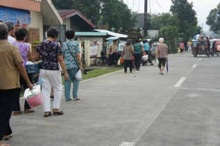 Assorted baskets with blessed mamon and assorted bread are taken back home after the mass.