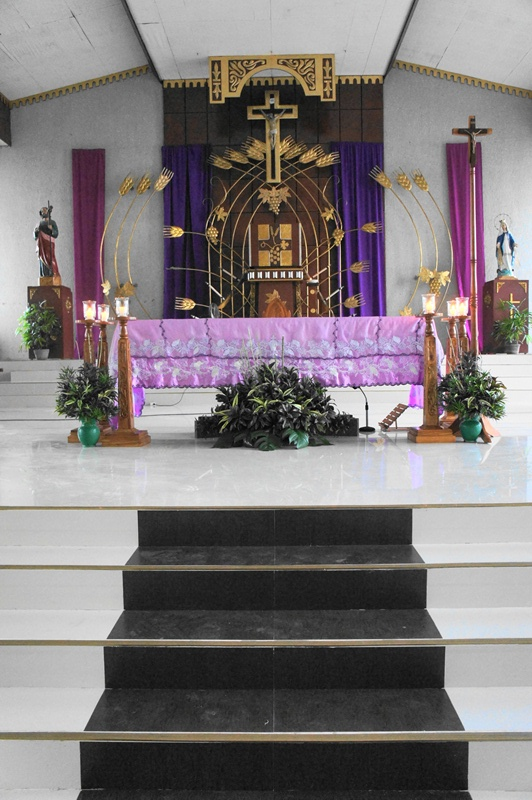 Subdued and simple altar adornments with purple hues at the First Sunday of Lent in Bulusan, March 9, 2014.