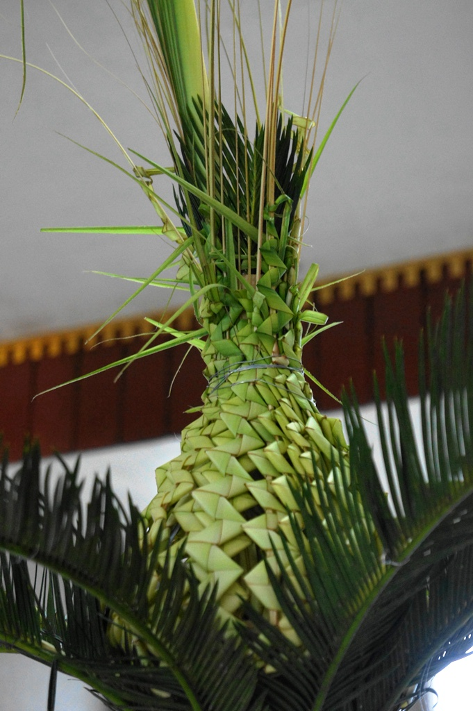 Pineapple shaped palaspas with oliba fronds as main accent at the altar.