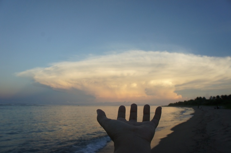 Hand selfie with the sky.
