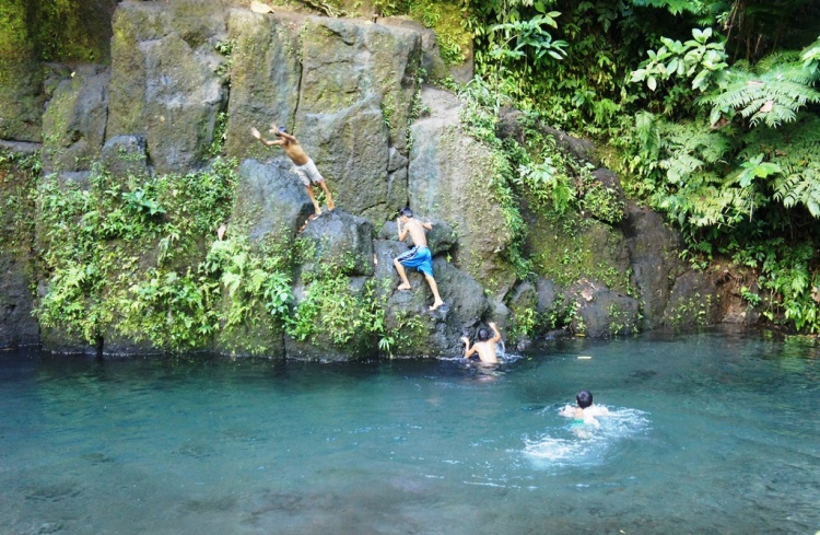 Local boys enjoying summer plunge in Bayugin River