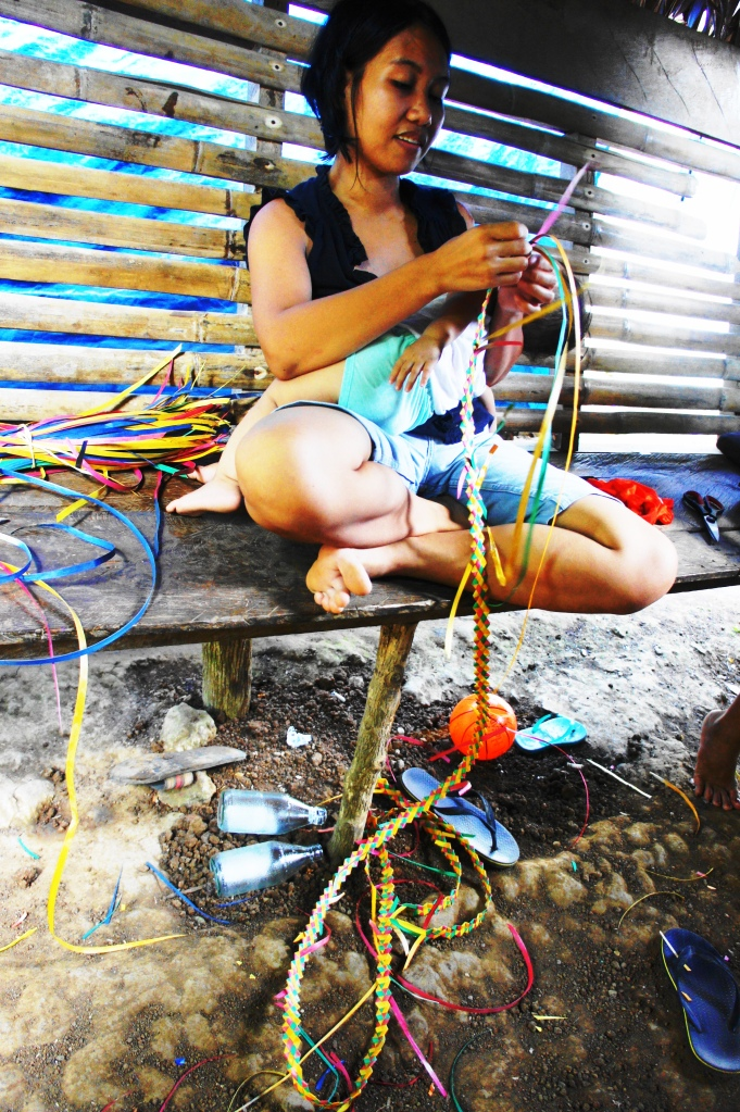 Multi-tasking mother in Barangay Santa Barbara, Bulusan, 2014.