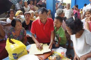 Checking the names of participants from their village
