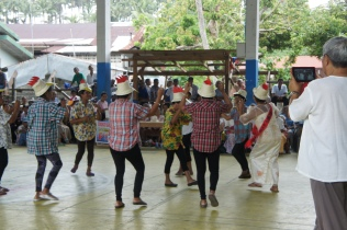 Younger set of seniors performing the chicken dance.