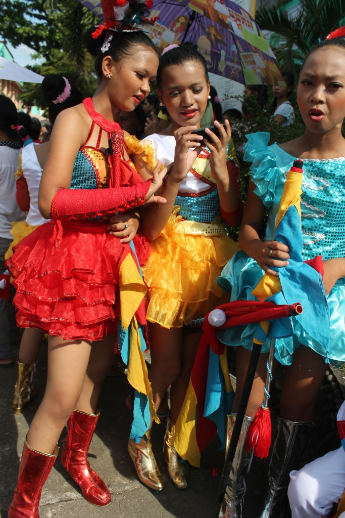 Members of the drum and lyre corps after the parade take time for selfie pics. (Bulusan, July 24, 2015)