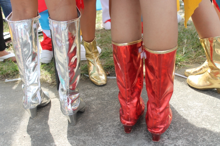 Colorful and shiny boots are part of the festive uniforms of the drum and lyre corps. (Bulusan, July 24, 2015)