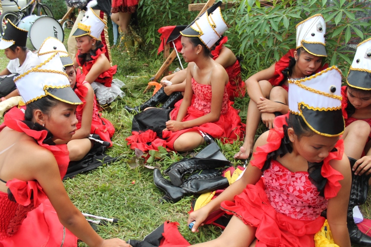 DLC participants from a local high school take their boots off to relax before their DLC number. (Bulusan, July 2015)