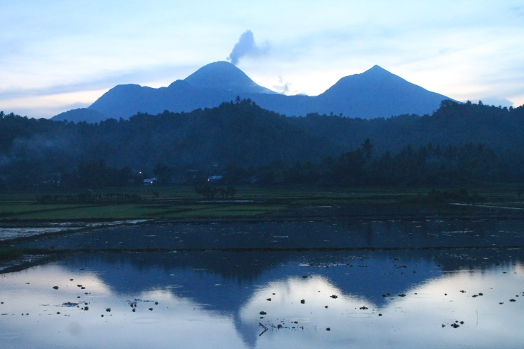 Bulusan Volcano at dusk viewed from the roadside of Baluarte still showing slight steam/ash emission on June 18, 2015.