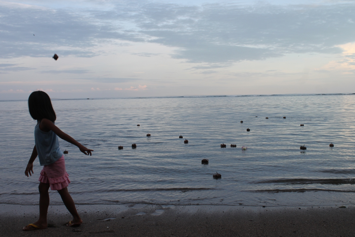 Boton fruts calmly floating at sea after a seaside play with local kids.